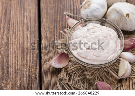 Homemade Aioli (garlic dip) on wooden background (close-up shot) - stock photo