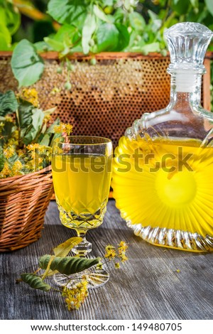 Homemade alcohol based on honey and lime - stock photo