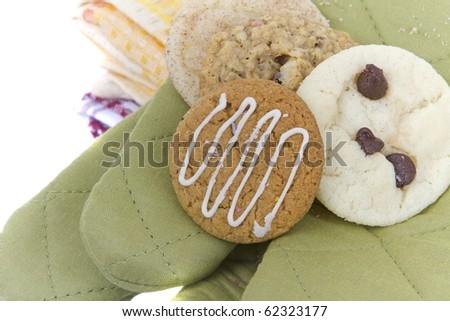 homemade allergen free cookies sit on cookng mitt - stock photo