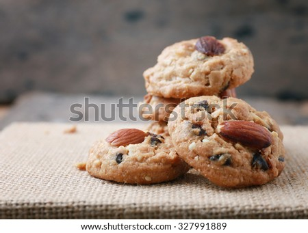 Homemade Almond cookies on a shabby wooden table background. - stock photo