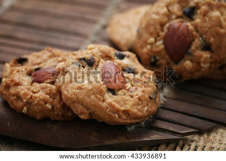 Homemade Almond cookies on a shabby wooden table background.(Selective focus)