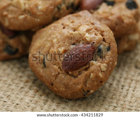 Homemade Almond cookies on wooden table background.