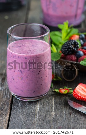 Homemade antioxidant berries smoothie on wooden table - stock photo