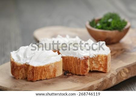 homemade appetizing crostini with soft cheese cream herbs - stock photo