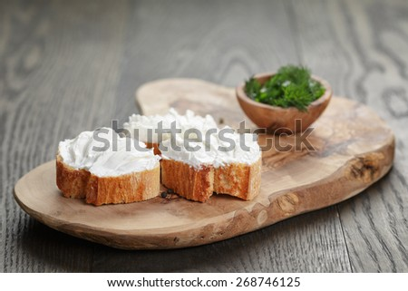 homemade appetizing crostini with soft cheese cream herbs - stock photo