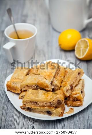 homemade apple and raisins pie made of flaky pastry - stock photo