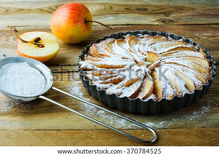 Homemade apple pie, fruit dessert, tart, apples and caster sugar on the wooden table, selective focus. Pastry. Dessert. Apple Pie. Apple Tart. Pie. Tart  - stock photo