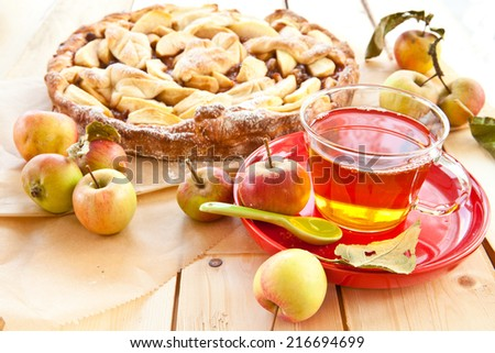 Homemade apple pie made with fresh organic apples and a cup of tea - stock photo