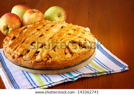 homemade apple pie on wooden table - stock photo