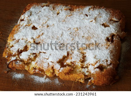 homemade apple pie, sprinkled with powdered sugar