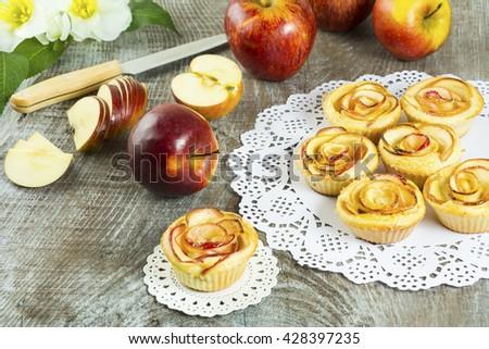 Homemade Apple rose cake. Gourmet apple cupcakes. Sweet dessert pastry. Homemade apple muffins.   - stock photo