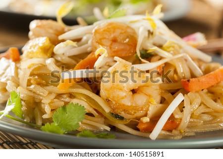 Homemade Asian Pad Thai with shrimp and cilantro - stock photo