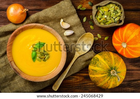 Homemade Autumn Butternut Squash Soup rustic wooden table - stock photo