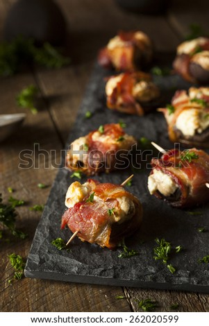 Homemade Bacon Wrapped Mushrooms Stuffed with Cream Cheese - stock photo