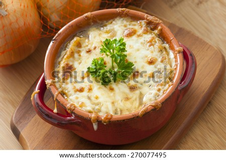 Homemade baked French Onion Soup with cheese - stock photo