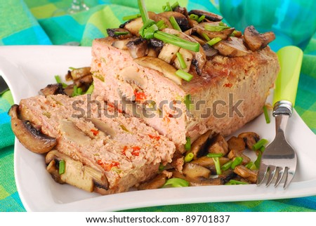 homemade  baked meatloaf stuffed with mushrooms ,red and green pepper - stock photo