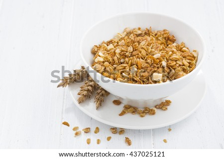 homemade baked muesli in bowl, horizontal - stock photo