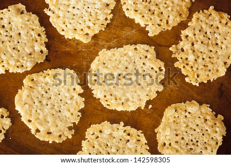 Homemade Baked Parmesan Cheese Crisp against a background - stock photo