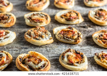 Homemade baking concept - french pastry snack rolls with spicy mushroom stuffing - stock photo