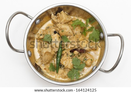 Homemade balti chicken pasanda, made with spices, yoghurt, cream and chopped coriander and chillies seen from above in a kadai ( karahi or wok) serving bowl, garnished with cilantro and a green chilli - stock photo