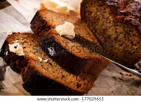 Homemade banana bread and butter.Selective focus on the butter and bread  - stock photo