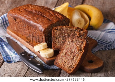 Homemade banana bread sliced on a table close-up. horizontal, rustic style - stock photo