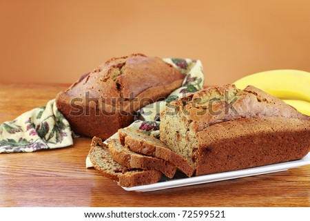 Homemade banana bread with fresh bananas and copy space. - stock photo
