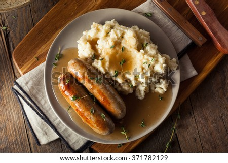 Homemade Bangers and Mash with Herbs and Gravy - stock photo