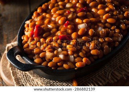 Homemade Barbecue Baked Beans in a Black Skillet - stock photo