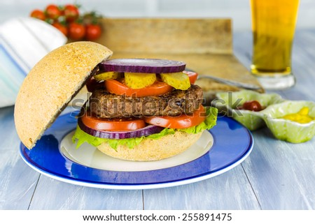 Homemade beef burger and a glass of beer
