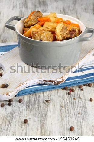 Homemade beef stir fry with vegetables in color pan, on wooden background - stock photo