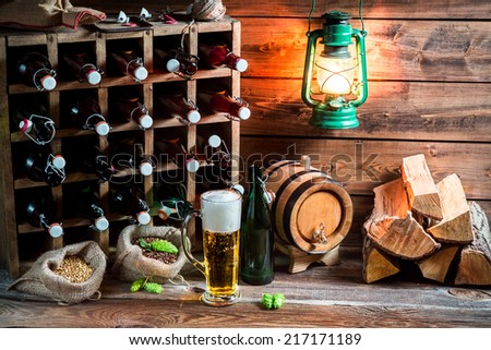 Homemade beer storeroom in the cellar - stock photo