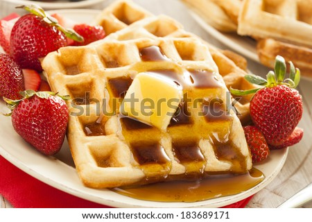 Homemade Belgian Waffles with Strawberries and Maple Syrup - stock photo