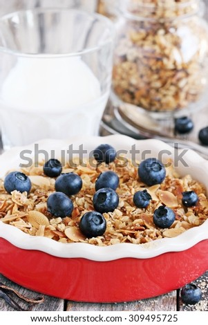 Homemade berry crumble with oatmeal-almonds crunch and fresh blueberry.Toned image.Selective focus