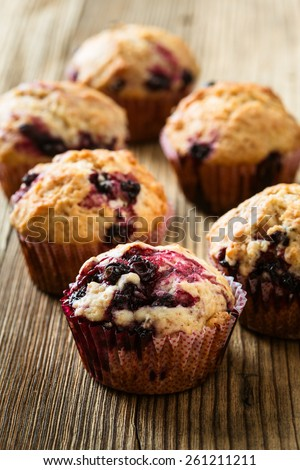 Homemade black berry muffins. Muffins with black currant for healthy breakfast on rustic wooden table - stock photo