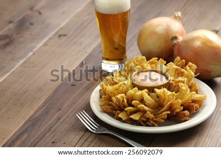 homemade blooming onion and beer, american food - stock photo