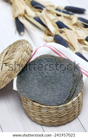 homemade blue corn tortilla, mexican traditional food - stock photo