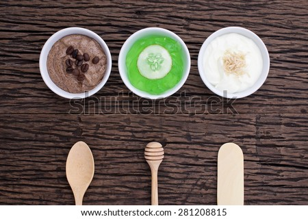 homemade body scrubs on wood background - stock photo