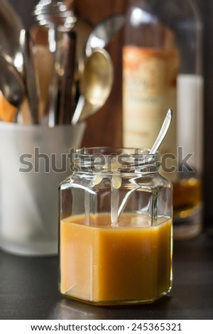 Homemade Brandy-flavored Cream Caramel Sauce in a Jar - stock photo