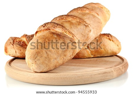homemade bread on wooden breadboard isolated white background - stock photo