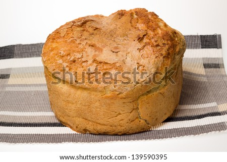 Homemade bread placed on napkin and white background