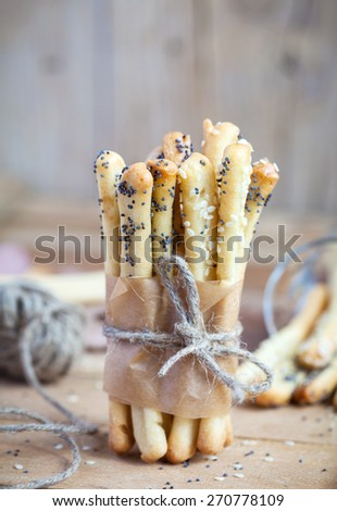 Homemade bread sticks with sesame and poppy seeds, selective focus - stock photo
