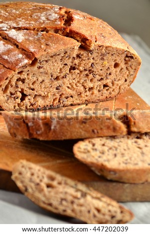 homemade bread with flax seeds on a wooden background