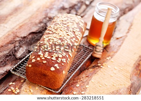 homemade bread with honey and oats - food and drink - stock photo
