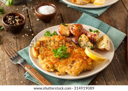 Homemade Breaded German Weiner Schnitzel with Potatoes
