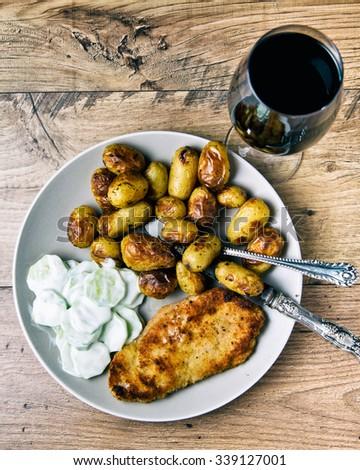 Homemade Breaded German Weiner Schnitzel with Potatoes - stock photo