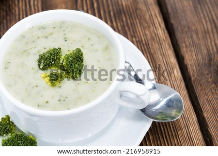 Homemade Broccoli Soup in a small bowl on wooden background - stock photo