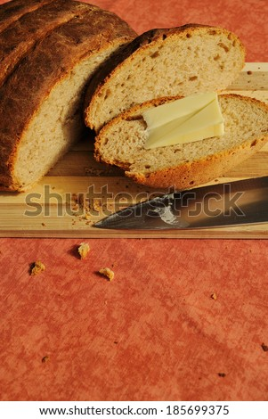 homemade brown bread with butter - stock photo