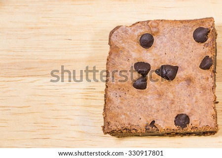 Homemade brownies sliced and  topping on  wooden background - stock photo