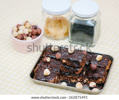 Homemade brownies with ingredients, selective focus - stock photo